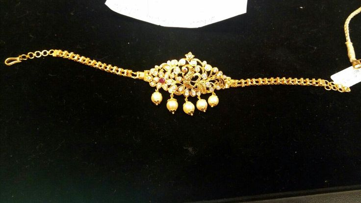 2 in 1 can be used as a neck piece or as a  vanki.. adorableness...loaded with uncut diamonds and single ruby with five pearls..2.8gms gold weight