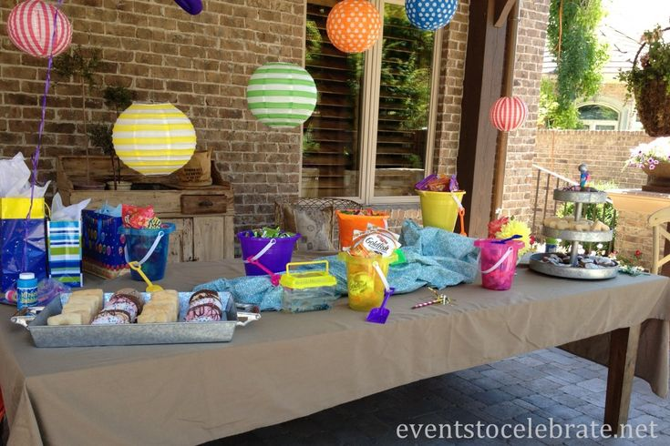 Swim Party Decorations - Table display with colorful lanterns and sand pails to hold treats.