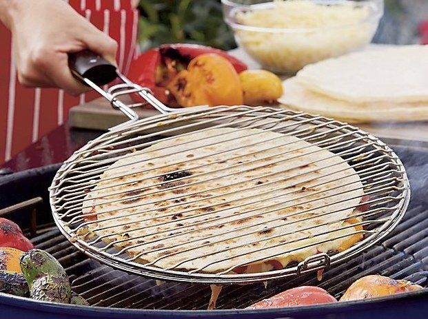 Next level quesadillas using a grilling basket over the grill or a campfire