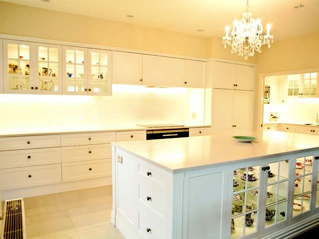 Charming kitchen with chandelier for ambience, and an adjoining scullery.