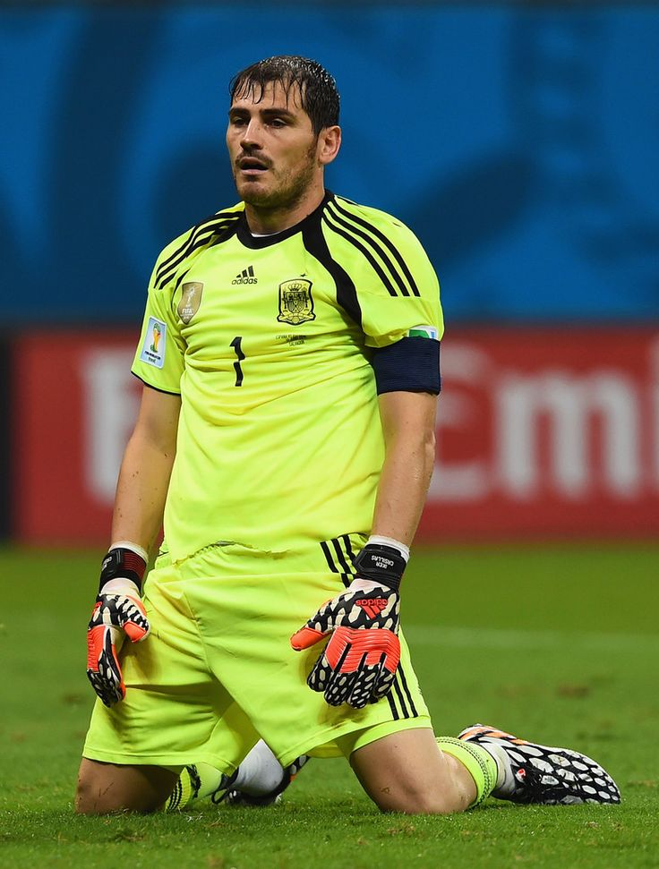 Iker Casillas of Spain looks dejected after the Netherlands second goal during the 2014 FIFA World Cup Brazil Group B match between Spain and Netherlands at Arena Fonte Nova on June 13, 2014 in Salvador, Brazil.