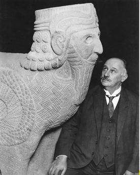 Max von Oppenheim with scorpion bird man / Photo 1930 Oppenheim, Max Freiherr von. German diplomat and archaeologist (Near Asia). 15.7.1860 Cologne – 15.11.1946 Landshut.  Max von Oppenheim next to a sculpture of a scorpion bird man found during his excavations at the western palace of King Kapara in Tell Halaf, Syria (sculpture, Aramaic, 10th Century BC). The sculptures were displayed in Oppenheim's Tell Halaf Museum in Berlin, opened 1930 and destroyed during the Second World War.  Photo…