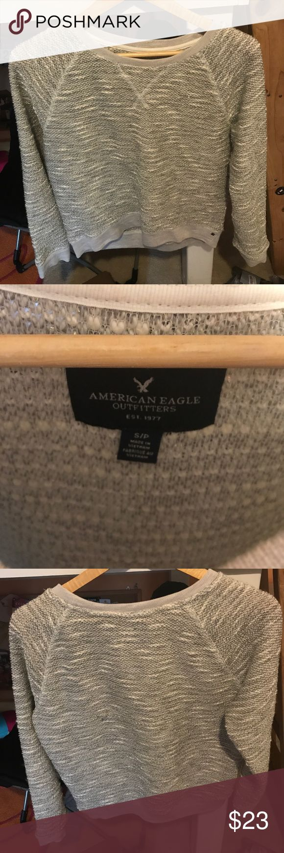 Grey American Eagle sweatshirt Slightly sparkly thread running throughout, not itchy, comfy sweater! Size S American Eagle Outfitters Tops Sweatshirts & Hoodies