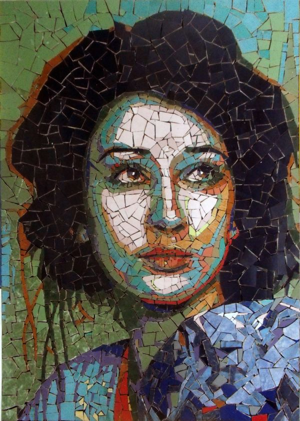 The artist drew the lady, and make it like this lady was drawn on the wall, and the wall was broken by using small squares. I like this portrait because of this idea.