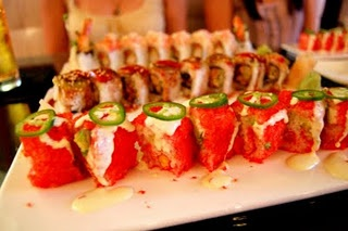 Houston's Crave Sushi Cheeta Roll :)  Crab meat, avocado, cucumber, spicy mayo, Sriracha sauce and combine it with flaming hot Cheetos!