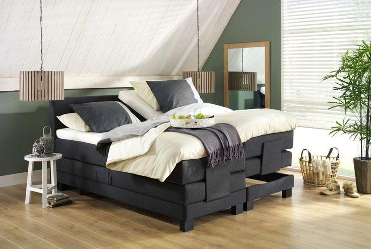 boxspring trondheim en hanglamp duco een modern bed in