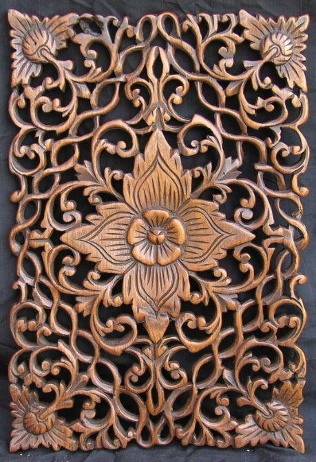 Carved teak floor panels with floral motif