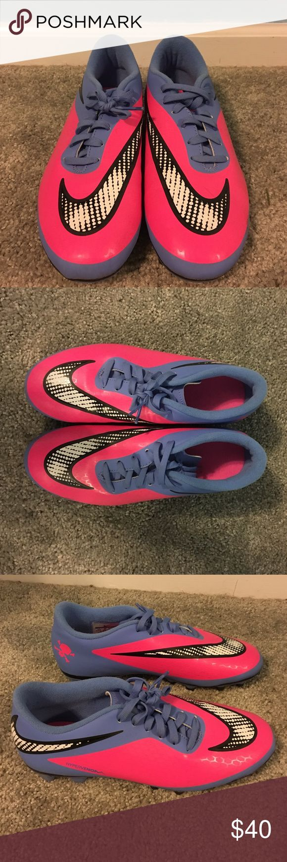 Women's size 7.5 Nike cleats Purple and pink Nike cleats. Only wore once in brand new condition. Nike Shoes Athletic Shoes