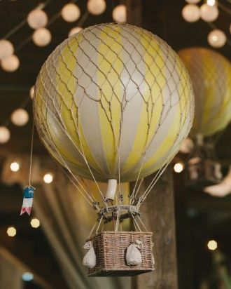 Here's a way to incorporate a hot air balloon into your big day without using it as your getaway mode-of-choice. More pics from Lauren and Jack's wedding are online.