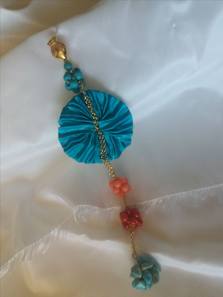 Cod-352 Turquoise shibori silk body adorned with gold plated ornaments and salmon, red coral stones and turquoise stones.  https://www.facebook.com/Crown-Art-Jewelry-685629774912291