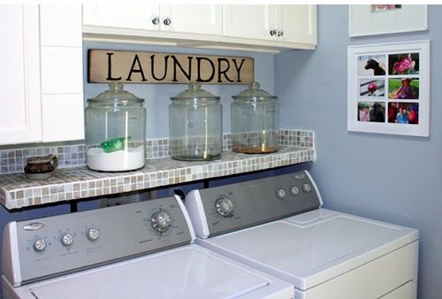 Like the shelf & the containers for laundry soap..... Made the shelf above my dryer/washer, and put my soap into a glass container, much better than the ugly box!  Also put pictures by my washer/dryer, makeover complete!