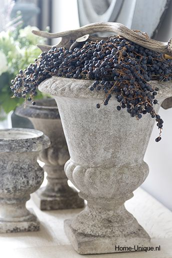 urns filled with grapes