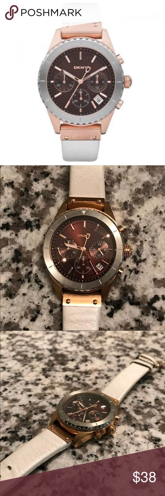 DKNY two tone watch Rose gold and silver watch with deep burgundy metallic  face! Pearlized white genuine leather straps. Needs battery which is the reason for low price ! Gently loved! Dkny Accessories Watches