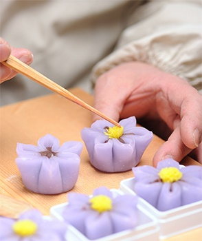 violet wagashi (pounded rice is shaped & stuffed with sweet bean paste)