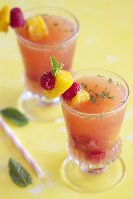 Ingredients: 1 1/2 mango, sliced into 1-inch cubes, set aside 10 pieces for garnish  1 tablespoon mango puree  1 pint fresh raspberries, rinsed, set aside 10 pieces for garnish  1 bottle rose wine  2 tablespoons agave nectar  14 ounces sparkling raspberry juice (I used Izze natural sparkling juice)  Mint, chopped for garnish