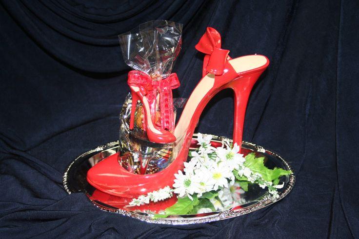 A wine bottle holder for the shoe girl!