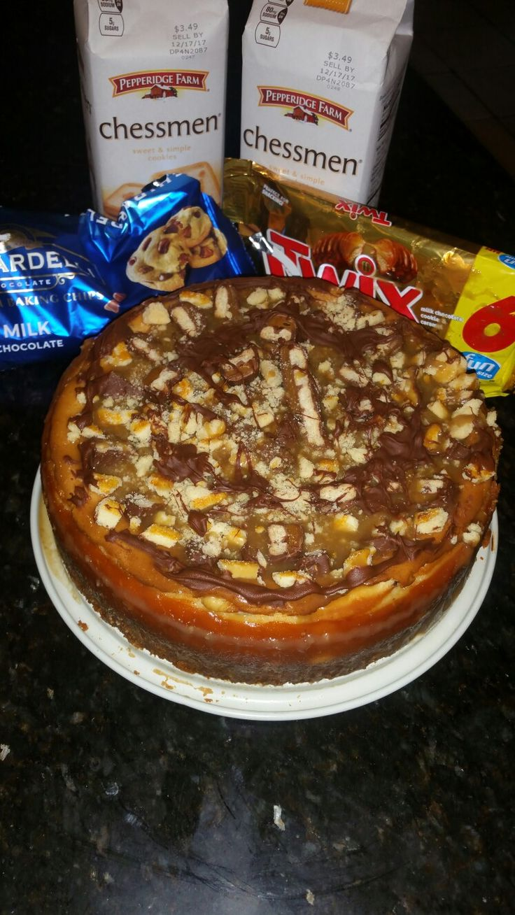 Homemade Twix Cheesecake with Chessmen cookie crust, homemade caramel sauce and Ghirardelli milk chocolate drizzle..by Allie M