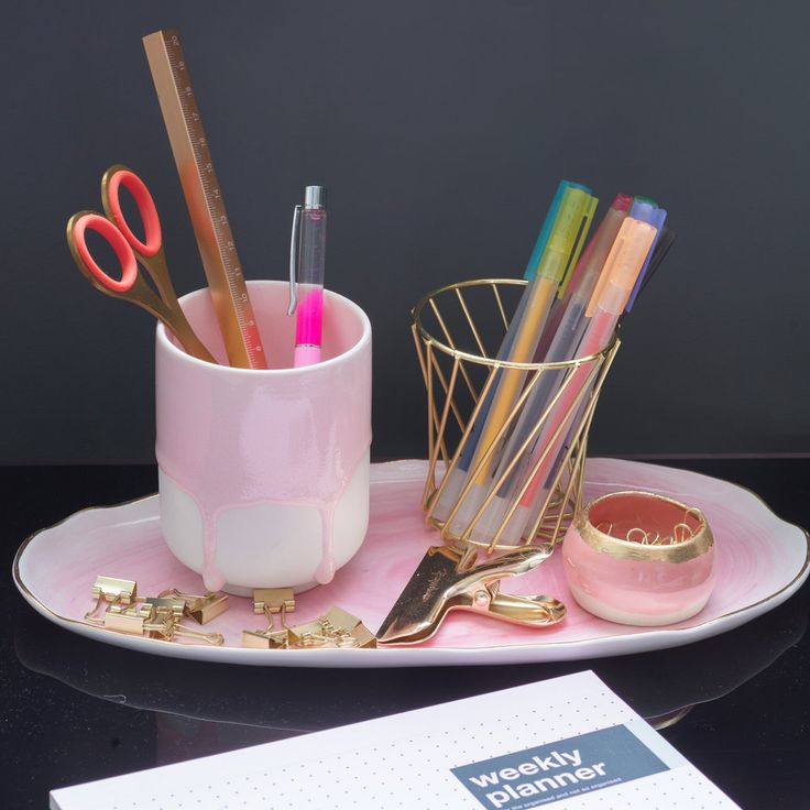 Pink tray with gold stationery and brass scissors