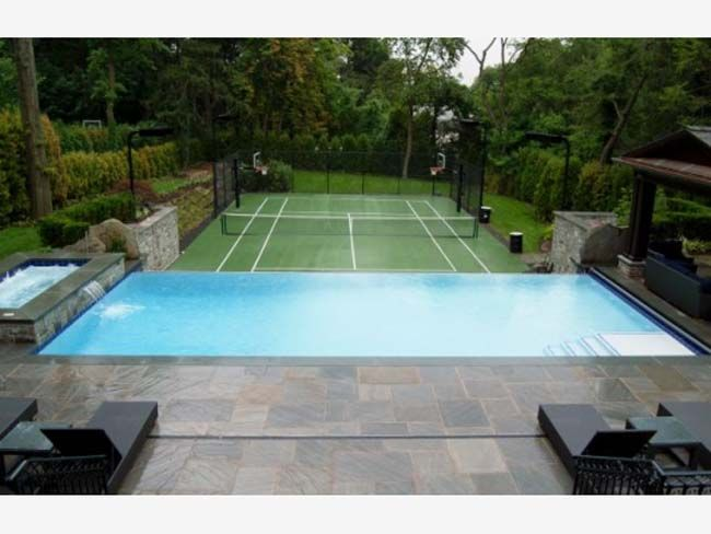 Pool overlooking play area - not a tennis court, but somewhere for soccer/hockey practice