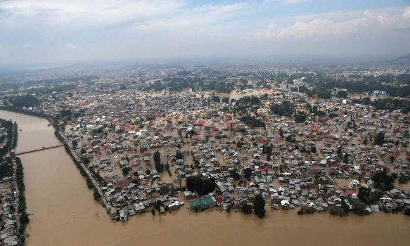 An aerial view shows buildings partially submerged in floodwaters in Srinagar, India, Tuesday, Sept. 9, 2014. The death toll from floods in Pakistan and India reached 400 on Tuesday and have put more than half a million people in peril and rendered thousands homeless in the two neighboring states. Photo: Dar Yasin, AP / AP