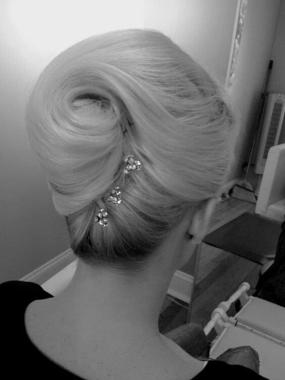 vintage-style French twist updo that twists the ponytail into a voluminous swirl