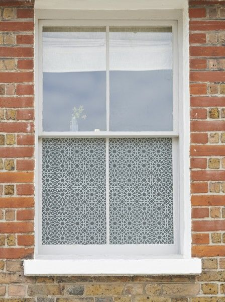 'Fes' decorative window frosted film by Brume, applied to the lower panel of a sash window