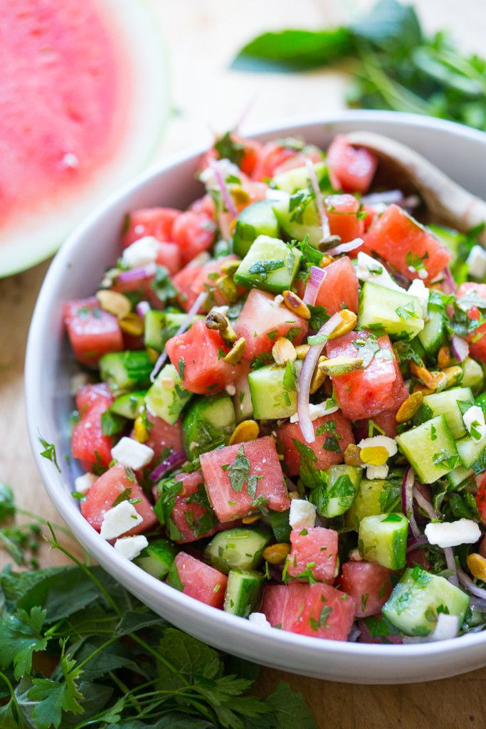 A Moroccan Watermelon Salad with Cucumber, Pistachios, Parsley, Mint, Onion and Crumbled Feta: refreshing, simple and delicious | www.feastingathome.com