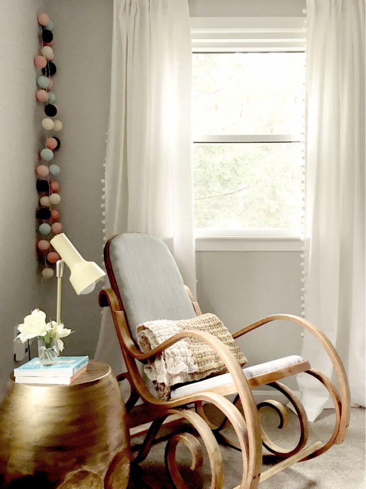 Gender neutral baby nursery. Benjamin Moore Moonshine. Vintage bentwood rocking chair. White pom poms curtains.