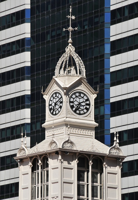 The Majestic Clock Tower at Lau Pa Sat standing gracefully against modern skyscrapers in the Central Business District by williamcho, via Flickr