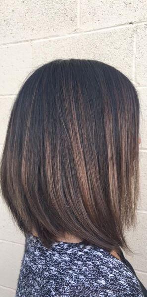 sublte brunette highlights on short hair - chic bob