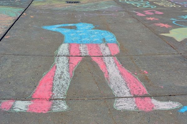 Approximately 100 Pennridge High School students created artwork on the sidewalks of the high school in honor of Sidewalk Chalk Day Thursday, April 25. News-Herald photo — DEBBY HIGH