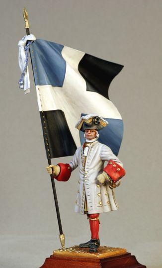 Porte-drapeau du Régiment de Lyonnais (1720). On comprend pourquoi les drapeaux français étaient carrés (de 1,60 à 1,80 m) et portaient une croix blanche en leur centre. découvrez les autres superbes réalisations de notre confrère Cyrill Conrad !