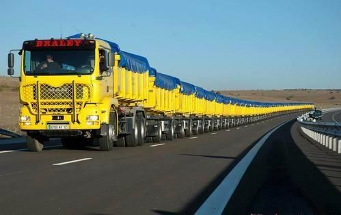 The Longest Truck in the World !! A road train is a trucking concept used in remote areas of Argentina, Australia, Mexico, the US & Canada to move freight efficiently. Instead of pulling one trailer, a road train pulls two or more of them. On 2/18/06 a Mack truck with 112 semi-trailers, 1,300 tons & 4,836 ft long, pulled the load 328 feet to a new record for a single mover. It was in Clifton, Queensland, that 70-year-old John Atkinson claimed a record, pulled by a tri-drive Mack Titan.