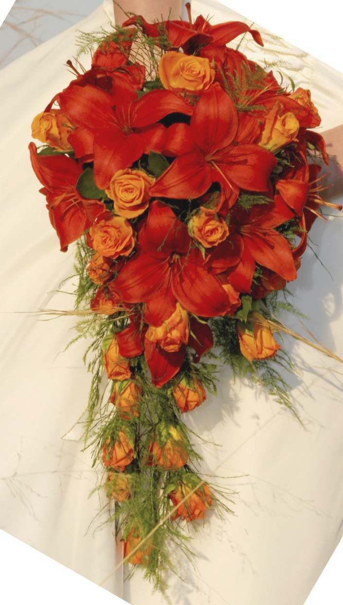 Cascading bouquet of red lilies and orange roses. Gorgeous, and you could switch the colors so there was orange lilies and red roses.
