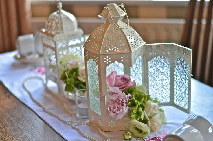 lanterns hydrangeas and candles | filled with cream pink and green flowers peonies hydrangeas roses and ...