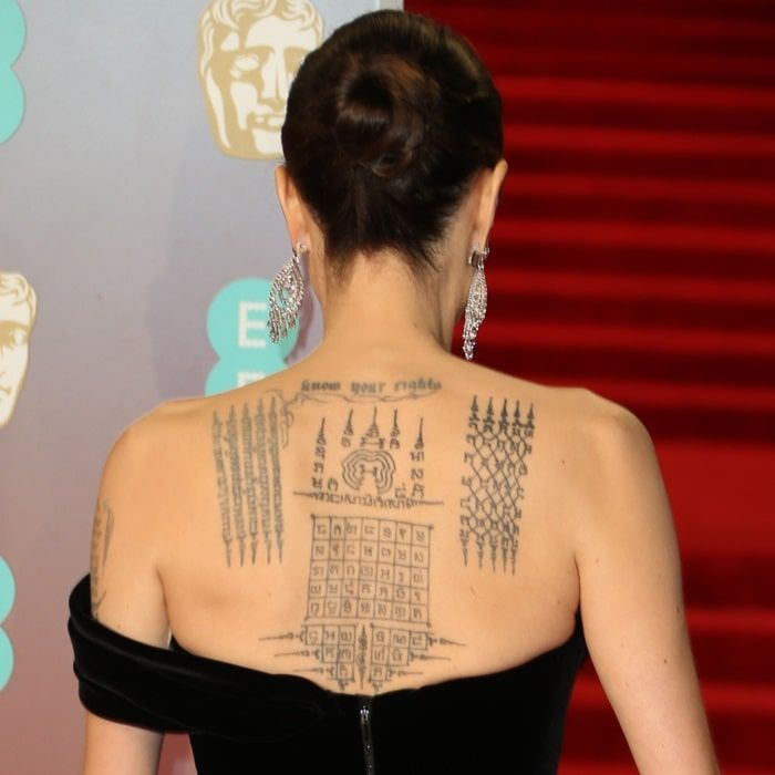 Angelina Jolie showing off her 'protection' tattoos done by a Thai monk 'to symbolically bind her' with Brad Pitt