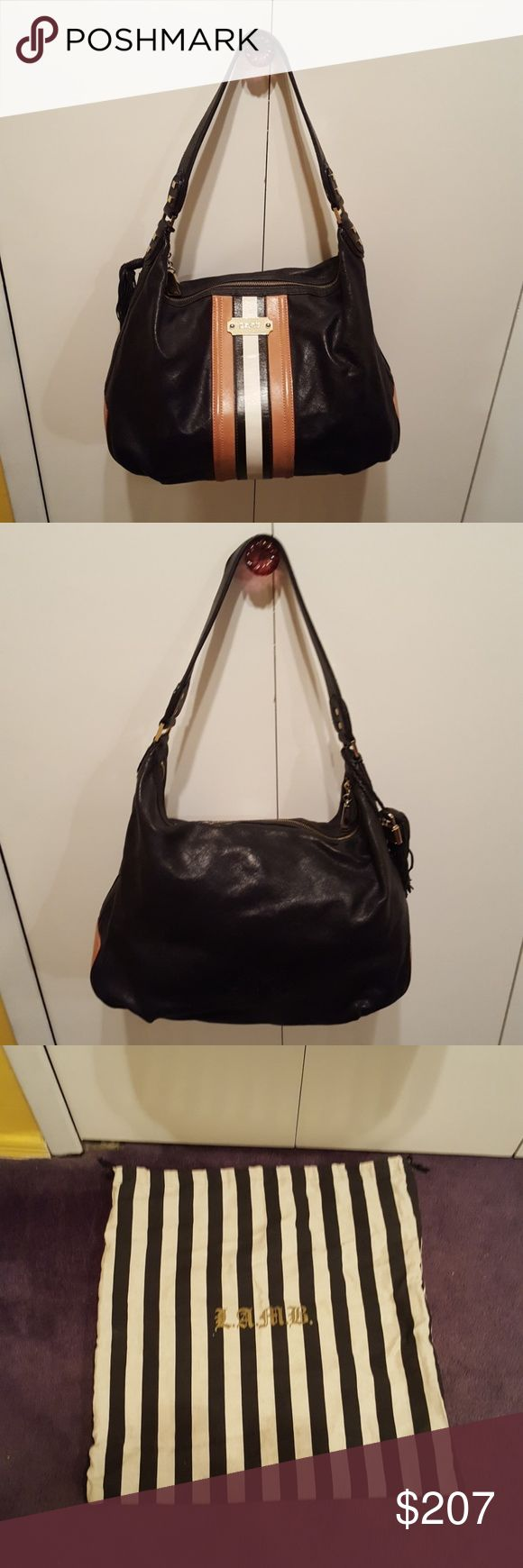 Lamb bag by GWEN STEFANI Leather bag like new . Nail polish stain in the inside zipper pocket picture shown above . Dust bag included LAMB  Bags Shoulder Bags