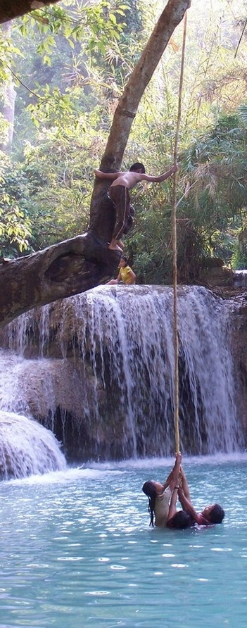 3 against 1; boy can't retrieve his vine in Luang Prabang, Laos • photo: WPM on Flickr