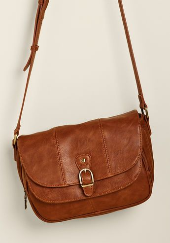Merry to Carry Bag in Brown - Why is this dark tan bag such a joy to bear? Because, beneath the buckle decorating its snapped flap, this faux-leather purse has a special spot for everything! Fill the intricate pocketry of this lined piece with all the things that make you happy, then sling its shoulder strap across your ensemble and set out to have a great day.