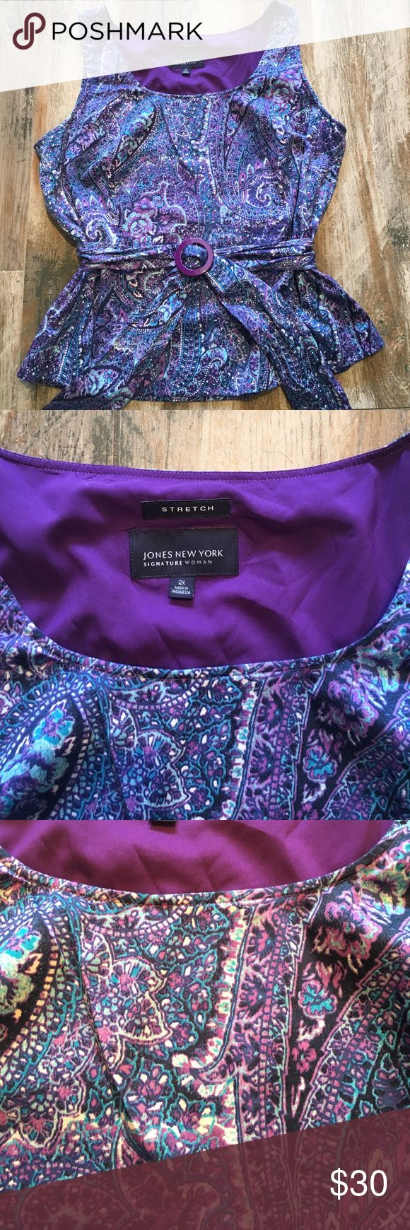 Jones New York or top Beautiful Jones New York top with sash that crosses in the front. It creates a beautiful waistline. From Pit to pit lying flat 24 inches. Length from back collar to bottom 24 inches. In EUC. All measurements are approximate. I do my best.❤️ Jones New York Tops Blouses