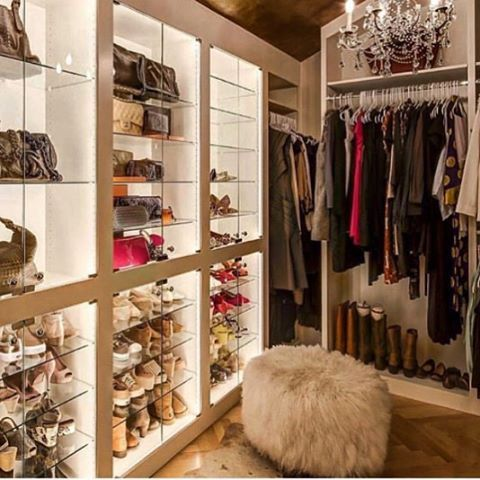 Glam Closet Features A Gold Leaf Barrel Ceiling Accented With Two Crystal  Chandeliers Over Built In Lighted Display Shelves Lined With Glass Shelves  Filled ...