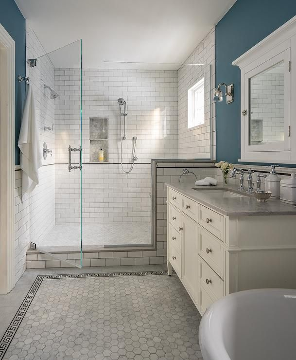Spa Like Bathroom Design Featuring Blue Bathroom Walls With An Ivory Washstand Fitted With Satin Nickel Blue Bathroom Walls Spa Like Bathroom Bathrooms Remodel