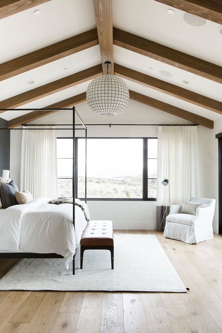 painted ceiling beams. See More. Master bedroom in blue grasscloth  wallpaper, statement chandelier, and leather bench