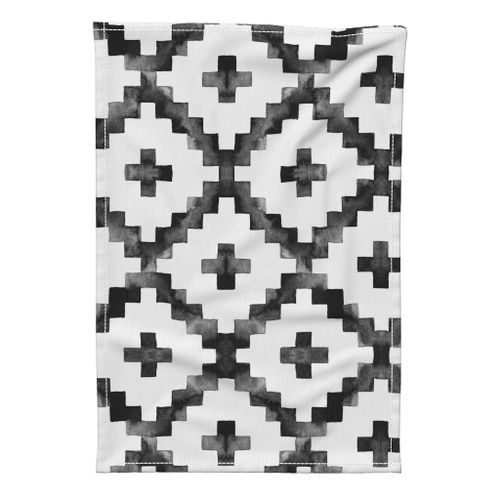black and white pillows napkins tea towels and placemats