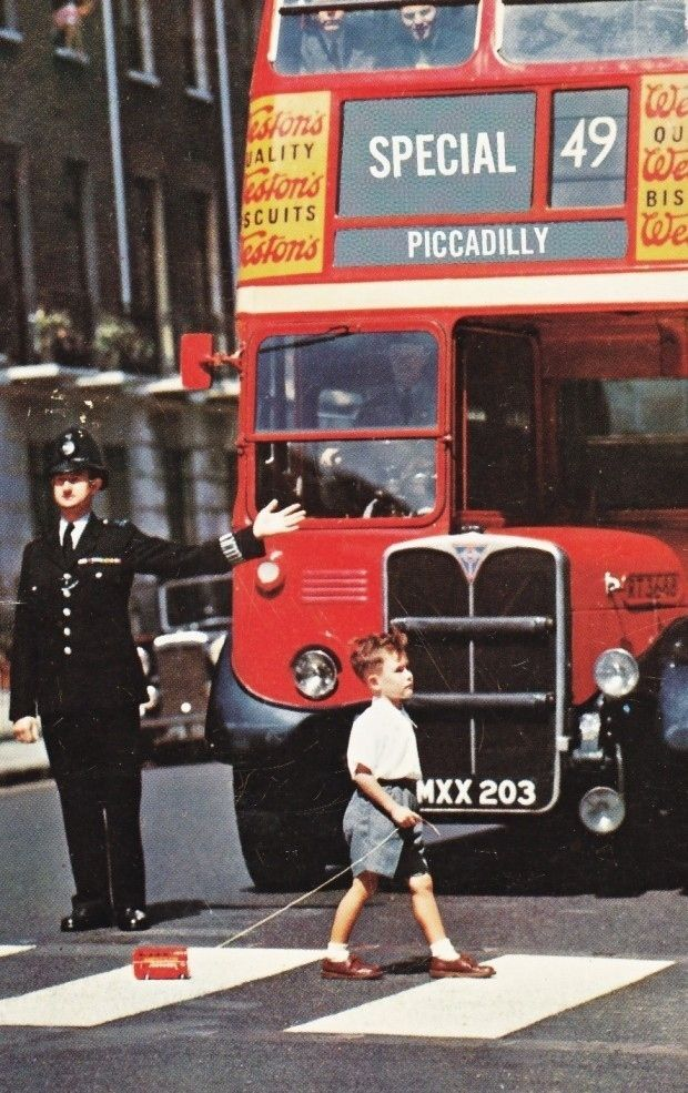 A London bus stops for a London bus. | The 16 Most Delightfully British Photos Of All Time