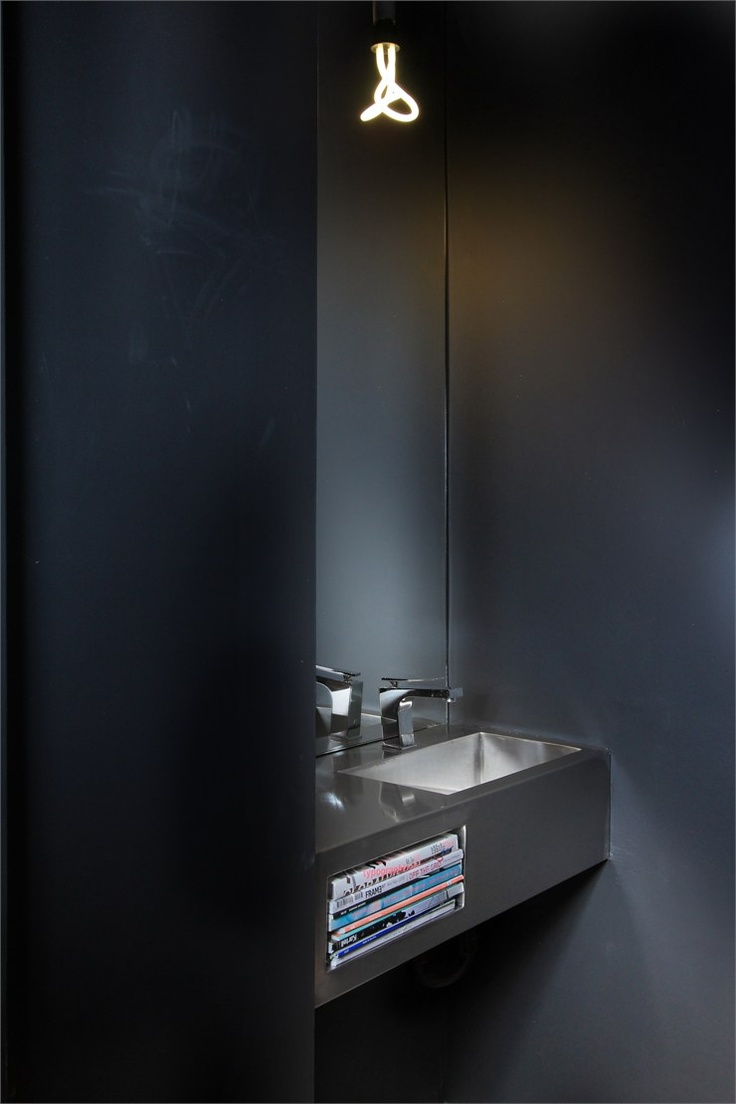 Minimalist powder room | Espace Le Moyne, Montréal, by Anne Sophie
