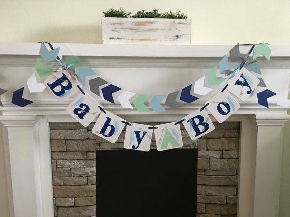 **Welcome to Classic Banners**  Tribal/Teepee/ Arrows/ Arrowhead Baby Shower Baby Boy or Baby Girl Or Baby and a name.. see the drop down menu to select number of letters for banner with or with out the matching 6ft strand of arrowhead paper garland Your color choices !!! I have hand stamped the letters in navy blue and the arrows in gray and feathers lt blue - I have permanently attached a mint green teepee (cut from cardstock) :) Leave me your color details in the note sectio...