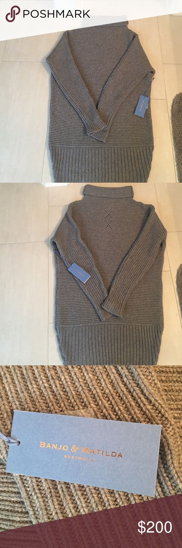 Brand new banjo and Matilda horizontal rib tunic Brand new banjo and Matilda Long horizontal rib tunic with tags. Never worn. Expensive brand from Australia. Size on this is S/M. Sweaters Cowl & Turtlenecks