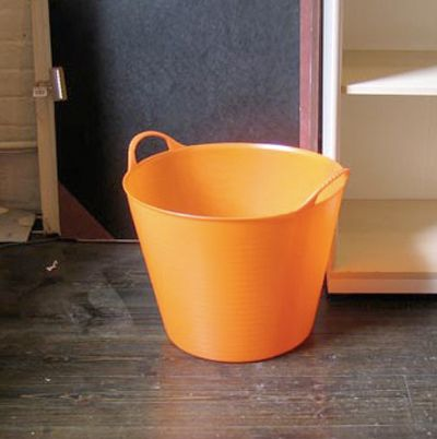 Use stackable laundry baskets that you can easily carry to the washing machine. you can stor them on a shelf