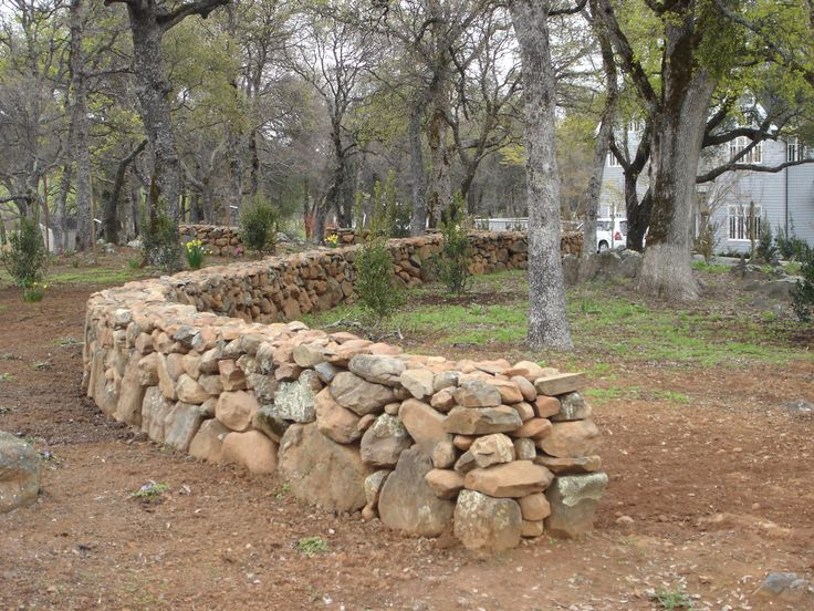 True dry stack stone fence if only they would allow this for Rock wall garden